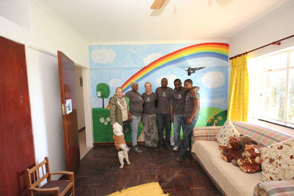 Receiving a tour of Iris House facilities